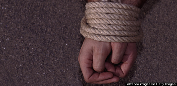 MAN-HANDS-TIED-ROPE-570